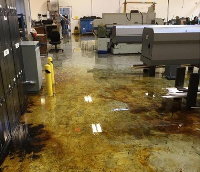 Cleaning Up Oil Spill In Commercial Facility Before