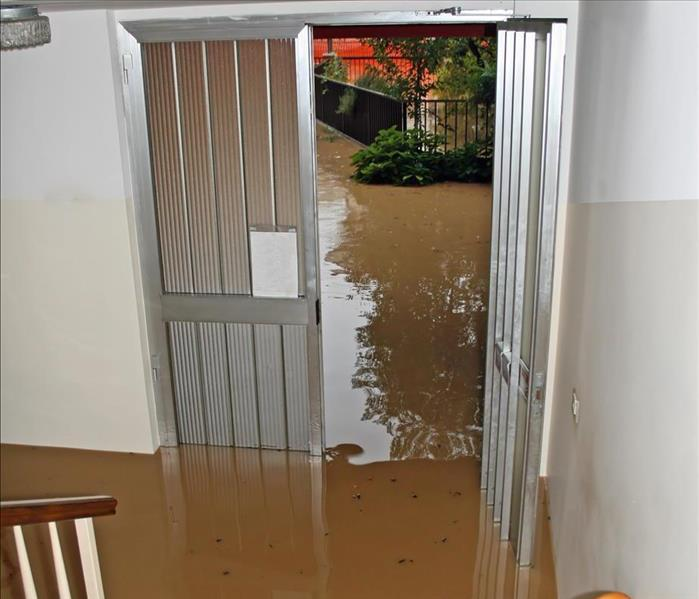 Entrance of a house fully flooded during flooding